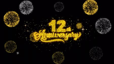 th : 12th Happy Anniversary Golden Greeting Text Appearance Blinking Particles with Golden Fireworks Display 4K for Greeting card, Celebration, Invitation, Gift, Events, Message, Holiday, Wishes .