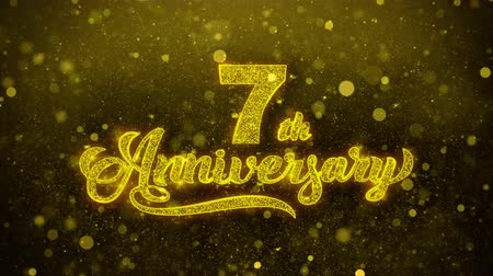 th : 7th Happy Anniversary Golden Greeting Text Appearance Blinking Particles with Golden Fireworks Display 4K for Greeting card, Celebration, Invitation, calendar, Gift, Events, Message, Holiday, Wishes .