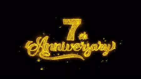 th : 7th Happy Anniversary Typography Written with Golden Particles Sparks Fireworks Display 4K. Greeting card, Celebration, Party Invitation, calendar, Gift, Events, Message, Holiday, Wishes Festival