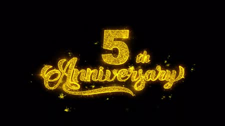 th : 5th Happy Anniversary Typography Written with Golden Particles Sparks Fireworks Display 4K. Greeting card, Celebration, Party Invitation, calendar, Gift, Events, Message, Holiday, Wishes Festival Stock Footage