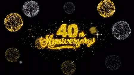 th : 40th Happy Anniversary Golden Greeting Text Appearance Blinking Particles with Golden Fireworks Display 4K for Greeting card, Celebration, Invitation, calendar, Gift, Events, Message, Holiday, Wishes . Stock Footage