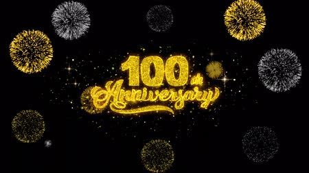st : 100th Happy Anniversary Golden Greeting Text Appearance Blinking Particles with Golden Fireworks Display 4K for Greeting card, Celebration, Invitation, calendar, Gift, Events, Message, Holiday, Wishes . Dostupné videozáznamy