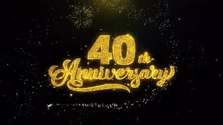 th : 40th Happy Anniversary Written Gold Glitter Particles Spark Exploding Fireworks Display 4K . Greeting card, Celebration, Party Invitation, calendar, Gift, Events, Message, Holiday, Wishes Festival