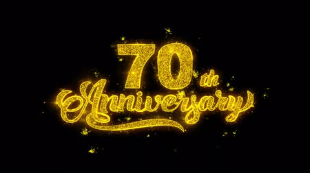 th : 70th Happy Anniversary Typography Written with Golden Particles Sparks Fireworks Display 4K. Greeting card, Celebration, Party Invitation, calendar, Gift, Events, Message, Holiday, Wishes Festival