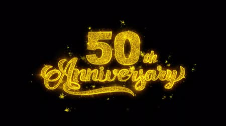 obrigado : 50th Happy Anniversary Typography Written with Golden Particles Sparks Fireworks Display 4K. Greeting card, Celebration, Party Invitation, calendar, Gift, Events, Message, Holiday, Wishes Festival