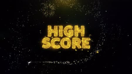 igen : High Score Text on Gold Glitter Particles Spark Exploding Fireworks Display. Sale, Discount Price, Off Deals, Offer Promotion Offer Percent Discount ads 4K Loop Animation. Stock mozgókép
