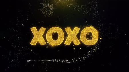 prozent : XOXO Text on Gold Glitter Particles Spark Exploding Fireworks Display. Sale, Discount Price, Off Deals, Offer Promotion Offer Percent Discount ads 4K Loop Animation.