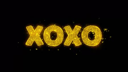 art : XOXO Text Sparks Glitter Particles on Black Background. Sale, Discount Price, Off Deals, Offer promotion offer percent discount ads 4K Loop Animation.