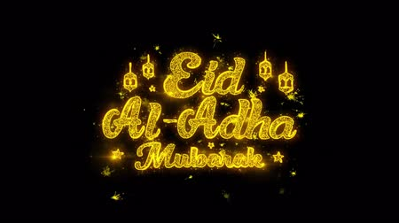 kaligrafia : Eid al-Adha mubarak wish Text Sparks Glitter Particles on Black Background. Greeting card, Wishes, Celebration, Party, Invitation, Gift, Event, Message, Holiday, Festival 4K Loop Animation. Wideo
