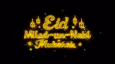 İslamiyet : Eid Milad-un-Nabi wish Text Sparks Glitter Particles on Black Background. Greeting card, Wishes, Celebration, Party, Invitation, Gift, Event, Message, Holiday, Festival 4K Loop Animation.