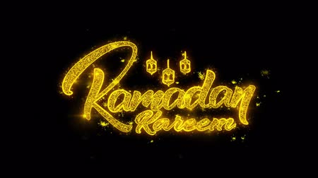 hónapokban : Ramadan Kareem wish Text Sparks Glitter Particles on Black Background. Greeting card, Wishes, Celebration, Party, Invitation, Gift, Event, Message, Holiday, Festival 4K Loop Animation.