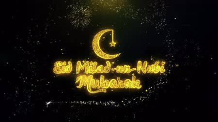 Аллах : Eid Milad-un-Nabi Text Wish on Gold Glitter Particles Spark Exploding Fireworks Display. Greeting card, Wishes, Celebration, Party, Invitation, Gift, Event, Message, Holiday, Festival 4K Loop Animation. Стоковые видеозаписи