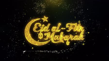 kaligrafia : Eid al-Fitr mubarak Text Wish on Gold Glitter Particles Spark Exploding Fireworks Display. Greeting card, Wishes, Celebration, Party, Invitation, Gift, Event, Message, Holiday, Festival 4K Loop Animation.