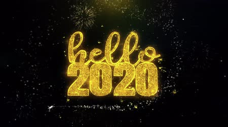 feliz ano novo : Hello 2020 New Year Text Wish on Gold Glitter Particles Spark Exploding Fireworks Display. Greeting card, Wishes, Celebration, Party, Invitation, Gift, Event, Message, Holiday, Festival 4K Loop Animation.