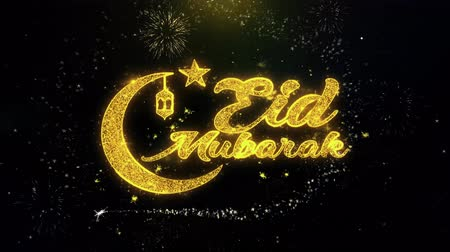 festivaller : Eid Mubarak Text Wish on Gold Glitter Particles Spark Exploding Fireworks Display. Greeting card, Wishes, Celebration, Party, Invitation, Gift, Event, Message, Holiday, Festival 4K Loop Animation. Stok Video
