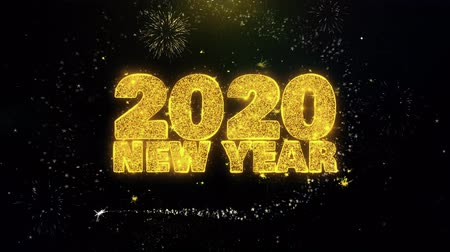 anos : 2020 New Year Text Wish on Gold Glitter Particles Spark Exploding Fireworks Display. Greeting card, Wishes, Celebration, Party, Invitation, Gift, Event, Message, Holiday, Festival 4K Loop Animation.