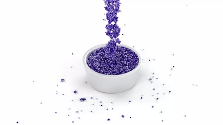 pegajoso : Shiny Purple And Slimy Fluid Of Many Micro Balls Flowing Into A Metallic Cup