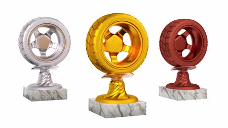 por que : Sport Wheel Gold Silver and Bronze Trophies with Marble Bases in Infinite Rotation on a white background Stock Footage