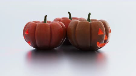 assombro : Three Halloween Pumpkins in Infinite Rotation on a white background