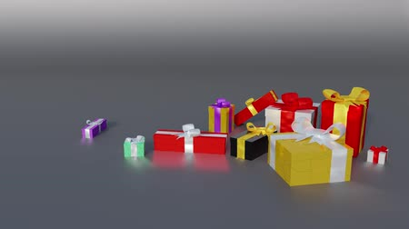 presente : Many Colored Christmas Gifts appearing in a dark background Stock Footage