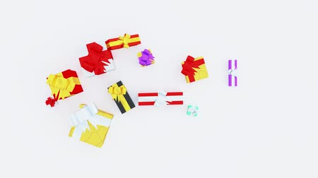 glistering : Top View Of Several Christmas Gifts And Little Ribbons With Stars In Popup With A White Background Stock Footage
