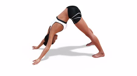 Woman in a Yoga Downward Facing Dog Pose in Rotation with a White Background