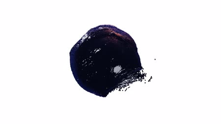 Top view of a dark liquid ball shaked left from a white background
