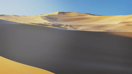 Linear Flight above Virtual Sand Dunes of a Desert with a blue sky