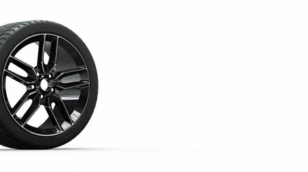 por que : Sport Wheel with black painted rim turnning right to left with a white background