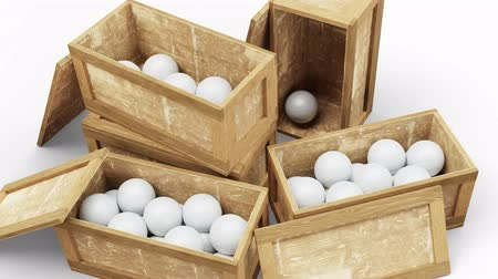 lids : Camera move and zoom above few opened wood transport box full with Handball balls