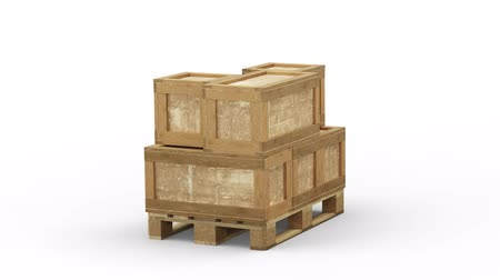 отправка : Turning around a Wood Pallet almost loaded with different size of Transport Box