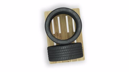 Top view and turning around of Sport Tires put straight on a wood pallet with a White Background