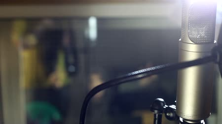 voz : the guy singing in the Studio Stock Footage
