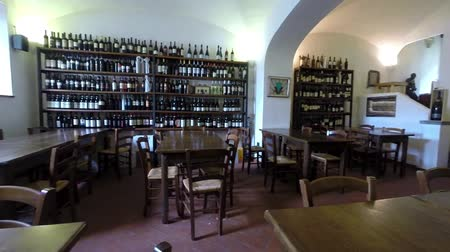 antika : BRACCIANO, LAZIO, ITALY - MAY 13, 2014: The restaurant Vino e Camino, located in the center of the square of the castle in Bracciano, is distinguished by a creative regional cuisine, with great attention to the quality of raw materials.  Stok Video