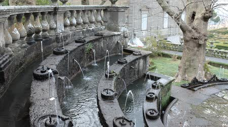 tiered : The Fountain Of The Lamps circular tiered fountain with smaller fountains,imitating Roman oil lamps,spout small jets of water which in the sunlight appear to blaze like lamp flames.Villa Lante, Italy. Stock Footage