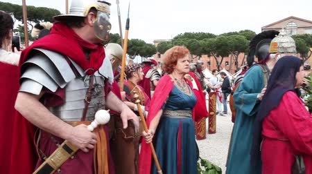 legionary : ROME, ITALY - APRIL 19, 2015: Roman legionary soldiers and women from the antique Rome faithfully reconstructed by the Roman Historical Group, making a re-enactment for the 2768th anniversary of Rome.
