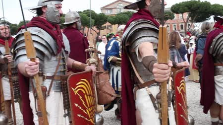 legionary : ROME, ITALY - APRIL 19, 2015: Group of legionaries faithfully reconstructed by the Roman Historical Group, which makes a historical re-enactment with the occasion of the 2768th anniversary of Rome.