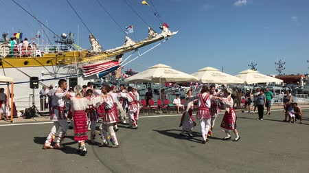 romanian traditional costume : CONSTANTA, ROMANIA - AUGUST 11, 2018: Folk ensemble featuring a Romanian folk music and dances show on the occasion of the Romanian Open Gates Day in the military harbor.