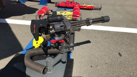 aircrew : CONSTANTA, ROMANIA - AUGUST 11, 2018: Door mounted machine gun for 330L Puma helicopter for naval missions, exposed on the occasion of Romanian Open Gates in the military harbor.