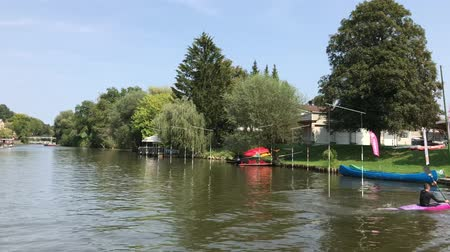 caiaque : LJUBLJANA, SLOVENIA - AUGUST 29, 2018: Kayak school is based on the beautiful river side of Ljubljanica river. You can learn from the best instructors with international experience.