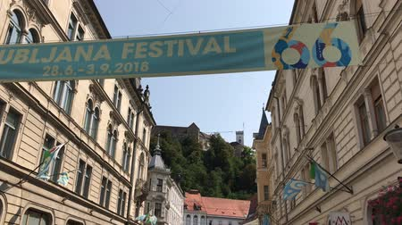 ljubljana : LJUBLJANA, SLOVENIA - AUGUST 29, 2018: View of Stritarjeva Ulica in Lubljana with the castle in the background during the Ljubljana Festival. Stock Footage