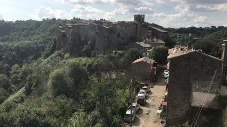 mediaeval : Calcata, the town of Viterbo, located at the north of Rome, overlooking the valley of Treja river. Stock Footage