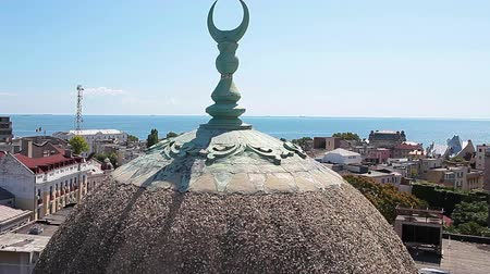 ottoman : Detailed view of the Grand Mosque dome with the city and the Black Sea in the background, Constanta, Romania. Stock Footage
