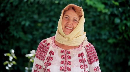 romanian traditional costume : Smiling Romanian senior woman wearing authentic national costume of the Romanian tradition.