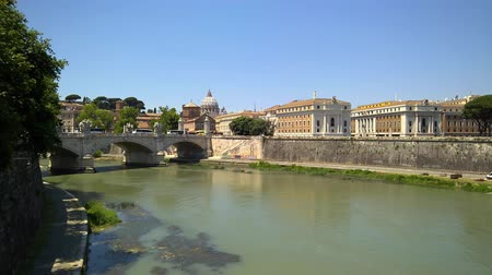emanuele : Rome view on Tiber river and Vittorio Emanuele II bridge, with St. Peter Basilica behind.
