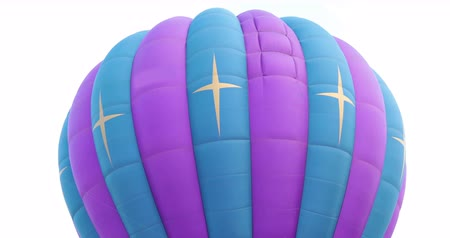 Detail of closeup of a purple blue hot-air balloon rising up from the ground.