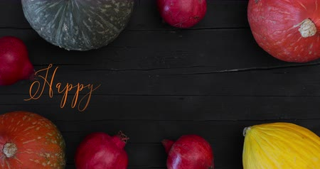 Thanksgiving background showing an animated greeting written on a wooden table with pumpkins, melon and pomegranates.