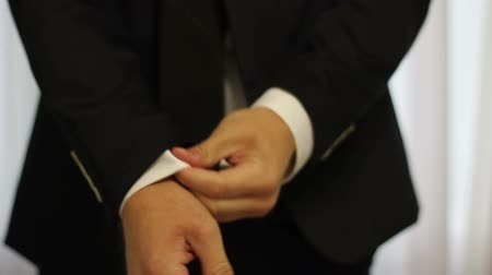 suit and tie : video footage man adjusts his shirt sleeves closeup Stock Footage