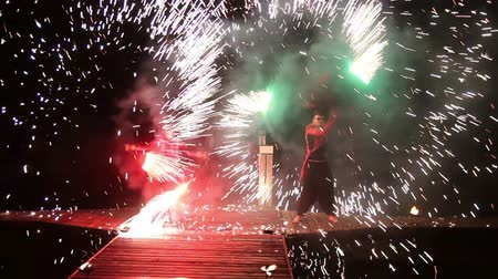 tradicional : colorful fire show at night on the dock near the river