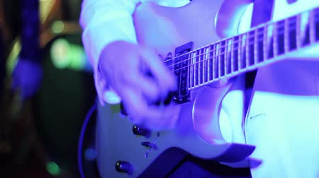 musicians stage : musician playing guitar in a disco lights with bokeh effect. front view Stock Footage